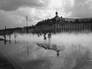 The misting, mirror pond of Bordeaux along the Gironde
